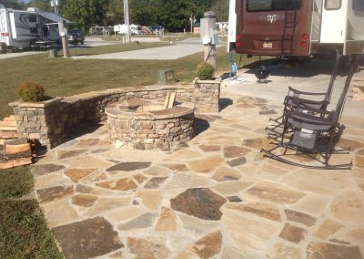 Flagstone - Custom Built Firepit, Seating wall and patio in RV Park